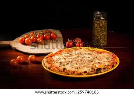 Delicious pizza with cheese, meat and sprouts on wooden table - stock photo