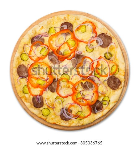Delicious pizza with fresh onions, pickles, peppers and carpaccio - thin pastry crust at wooden round desk, isolated at white background above view - stock photo