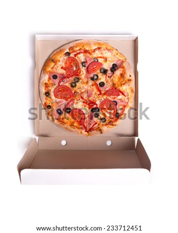Delicious pizza with ham and tomatoes in box, isolated on white background  - stock photo
