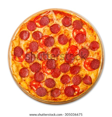 Delicious pizza with tomatoes and pepperoni - thin pastry crust at wooden round desk isolated at white background, above view - stock photo
