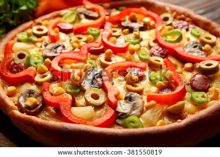 Delicious pizza with vegetables and meat, close-up - stock photo