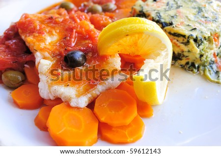 delicious plate of fish and carrot