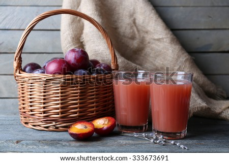 Delicious plum juice with fruits on table close up - stock photo