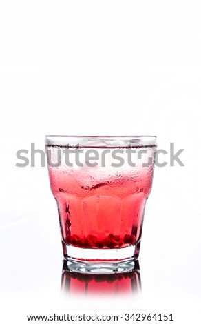 Delicious pomegranate cocktail on the white background - stock photo