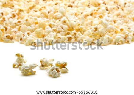 Delicious popcorn close up with shallow depth of field over white background - stock photo
