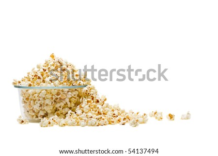Delicious popcorn in glass bowl over white background - stock photo