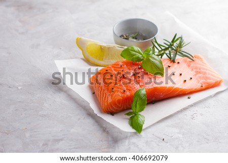 Delicious portion of fresh salmon fillet with aromatic herbs and spices, selective focus. For healthy food, diet or cooking concept - stock photo