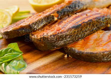 Delicious  portion of fresh salmon fillet with lime cooked on a grill or BBQ - stock photo