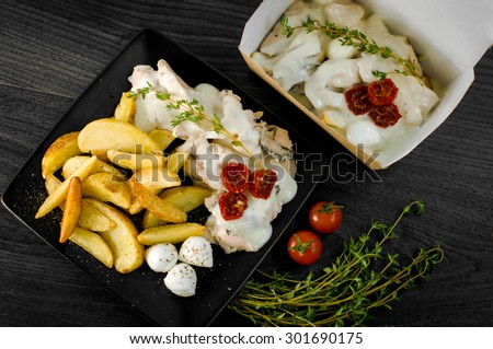 Delicious portion potatoes rustic fillet with aromatic herbs - stock photo
