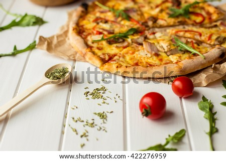 delicious portioned pizza and text space on white wooden background top view - stock photo