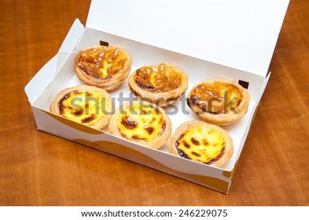 delicious portuguese egg tart on white box - stock photo
