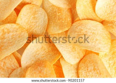 Delicious potato chips closeup - stock photo