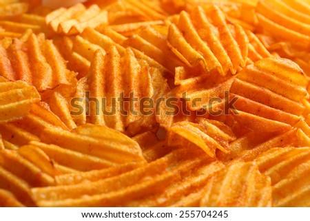 Delicious potato chips closeup background - stock photo