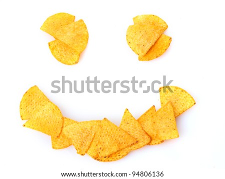 Delicious potato chips smile shape isolated on white