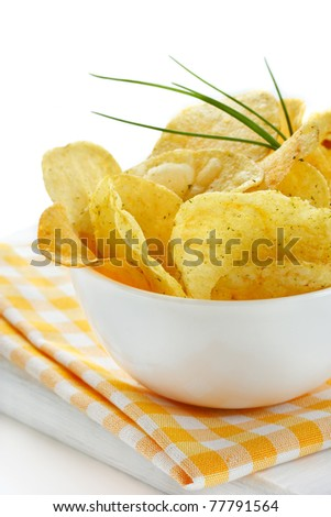 Delicious potato chips with spices in a white bowl. - stock photo