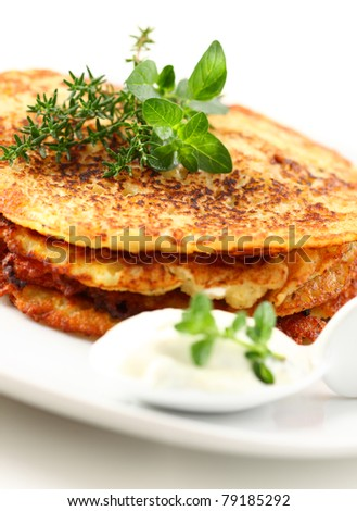 Delicious potato pancakes with curd cheese and herbs - stock photo