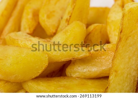 Delicious potato wedges with sauce. Fast food.  Macro. Can be used as a whole background. - stock photo