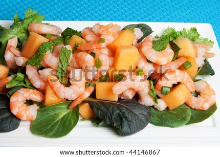 Delicious prawn and melon salad served with asian greens