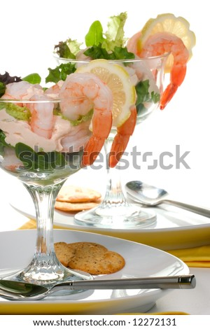 Delicious Prawn Cocktail.  Fresh jumbo shrimps, cream, lettuce leaves, lemon wedge and zesty sauce. Appetizer served in cocktail glass with whole wheat crackers.