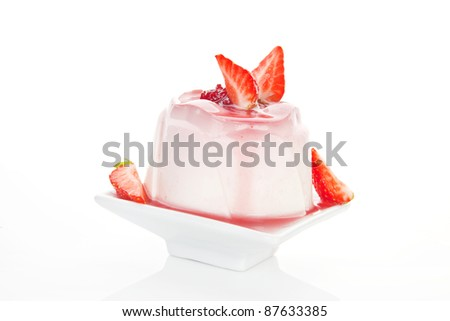 Delicious pudding dessert with fresh strawberries and cream isolated on white background. Culinary sweets concept. - stock photo