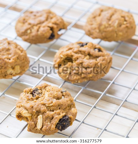 Delicious raisin cookies from the oven, on the grill. - stock photo