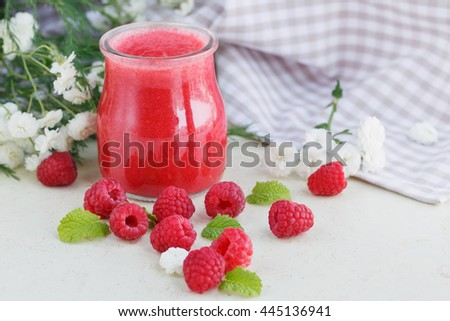Delicious raspberry smoothie or milk shake with fresh berries. Fresh yogurt with raspberry. Healthy breakfast.