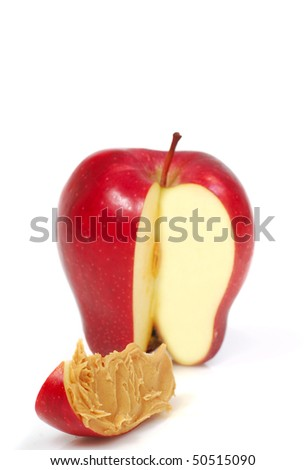 Delicious red apple slice with peanut butter spread on it - stock photo