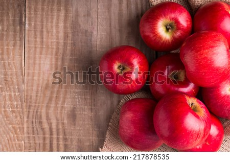 Delicious red apples on the wooden table, up view - stock photo