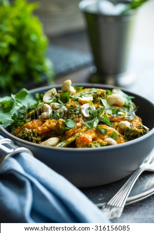 Delicious red curry chicken with broccoli and cashews - stock photo