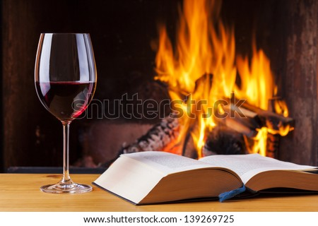 delicious red wine at romantic fireplace - stock photo