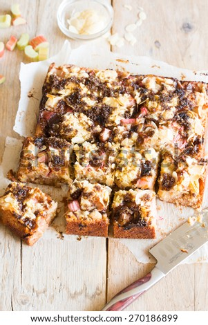 Delicious rhubarb cake with almonds and hazelnut flour - stock photo