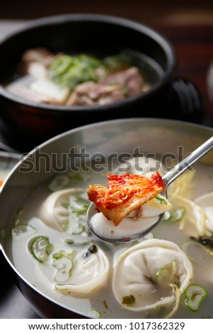 Delicious rice cake and dumpling soup in a hot pot