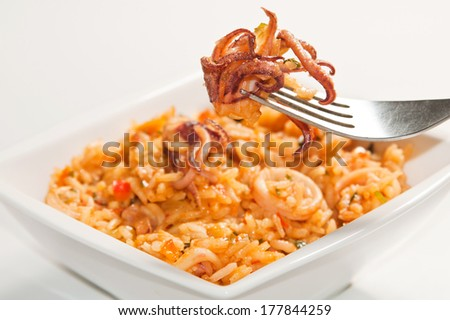 Delicious rice with squid - stock photo