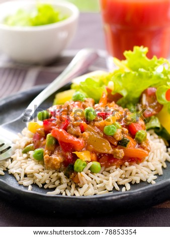Delicious rice with vegetables  and parsley. Selective focus