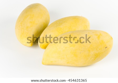 Delicious ripe mango with green leaf on white background - stock photo