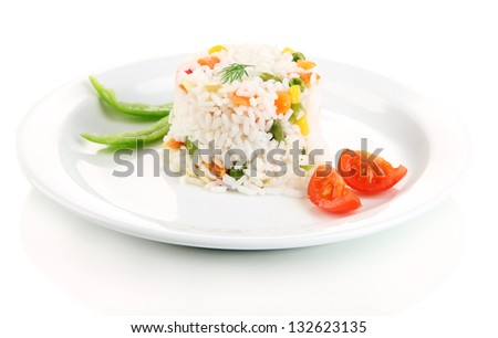 Delicious risotto with vegetables, isolated on white - stock photo