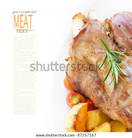 Delicious roasted and baked Veal knuckle with potatoes - stock photo