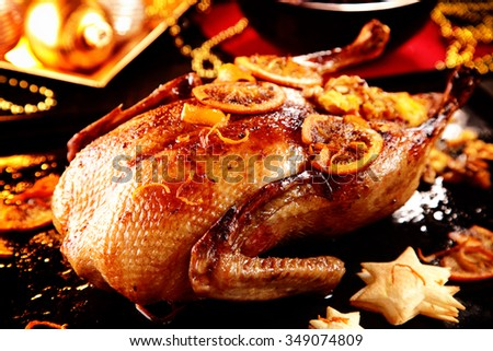 Delicious roasted Christmas turkey glazed with spices and orange and served with crispy pastry stars on a festive table - stock photo