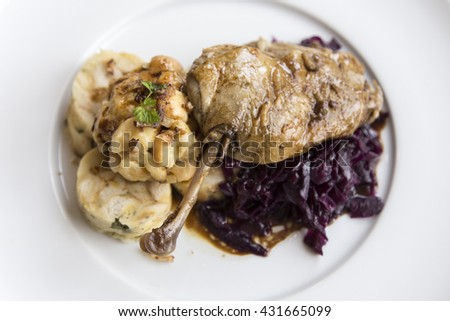 delicious roasted duck with red cabbage and dumplings - stock photo