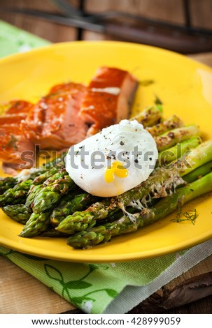 Delicious roasted green asparagus, poached egg and smoked salmon on plate - stock photo
