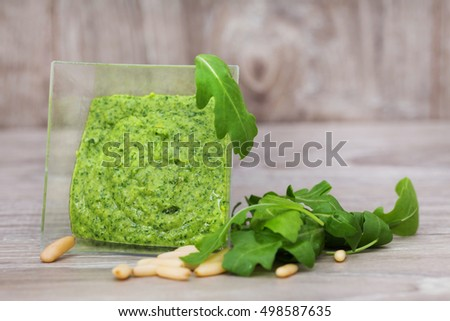 delicious rocket pesto over wooden background