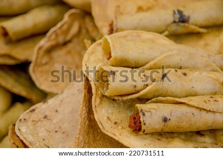 delicious rolled tacos guatemala typical food close up - stock photo
