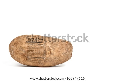 Delicious russet potato with a nutrition label ready to be baked - stock photo