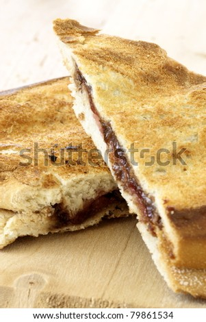 delicious rustic warm fresh hazelnut and chocolate spread sandwich with strawberries jelly or jam - stock photo