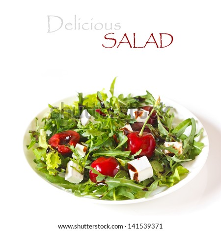 Delicious salad with arugula, sweet cherry and goat cheese.