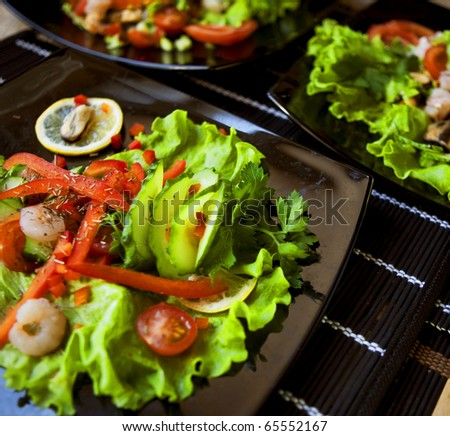 delicious salad with seafood
