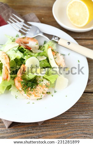 Delicious salad with shrimps, lettuce and cheese. Seafood