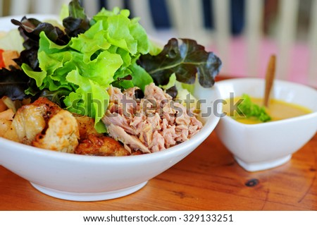 Delicious salad with tuna, chicken and vegetables (Healthy food) - stock photo