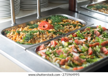 Delicious salads on the buffet table at restaurant - stock photo