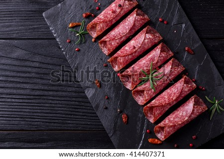 Delicious salami with basil and wine, selective focus - stock photo